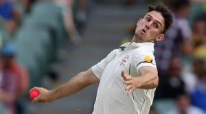 "Australia's Mitchell Marsh bowls during their cricket test against New Zealand in Adelaide, Friday, Nov. 27, 2015. This match is the sport's first ever day-night test and the use of the ""experimental"" pink leather ball replacing the standard-issue red for the first time in a format that dates back to the 1870s. (AP Photo/Rick Rycroft)"